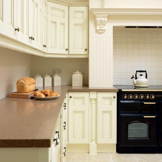 Take a tour around a cream painted kitchen kitchens for Tiled chimney breast images