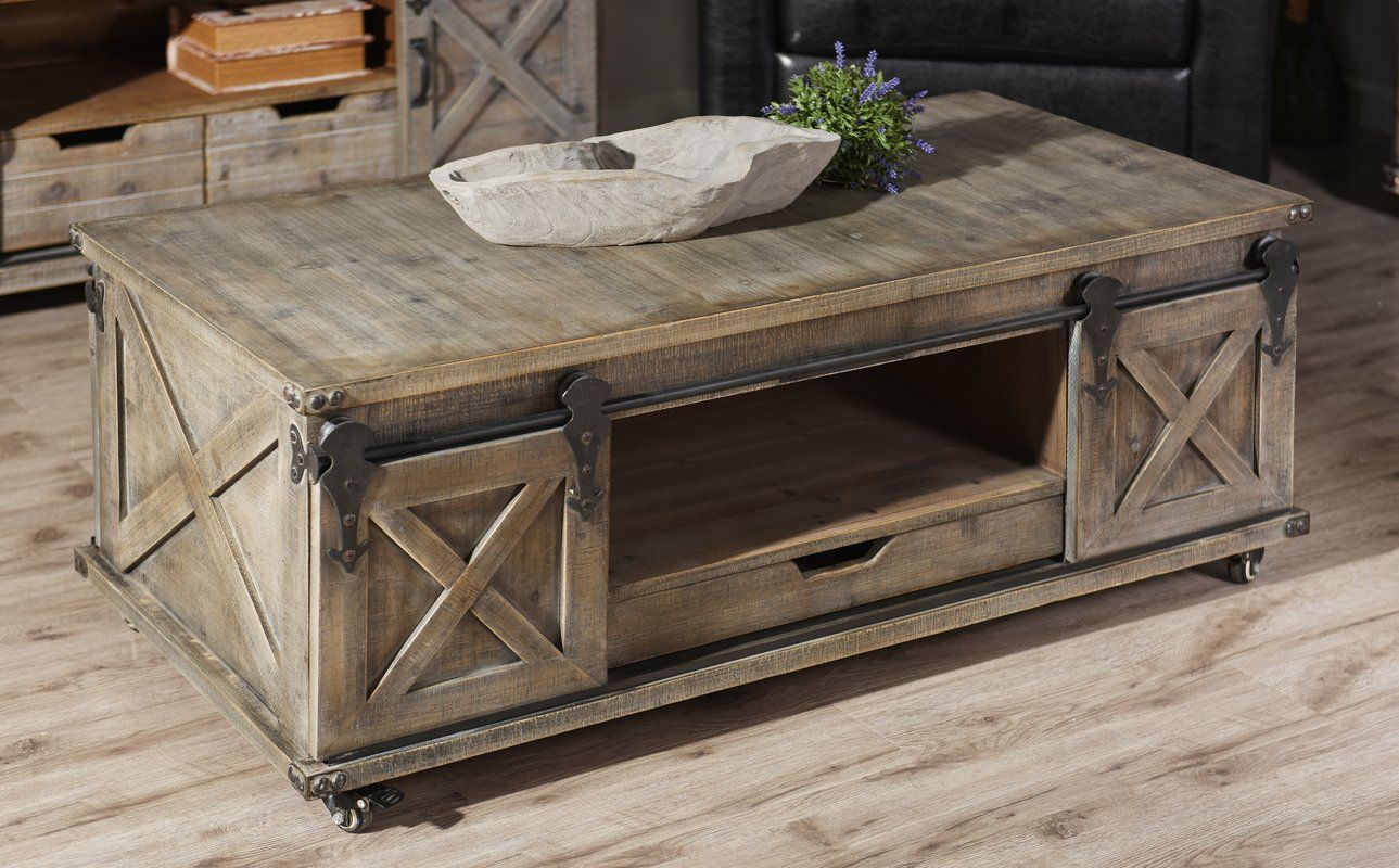 Magnus Solid Wood Wheel Coffee Table With Storage Door Coffee
