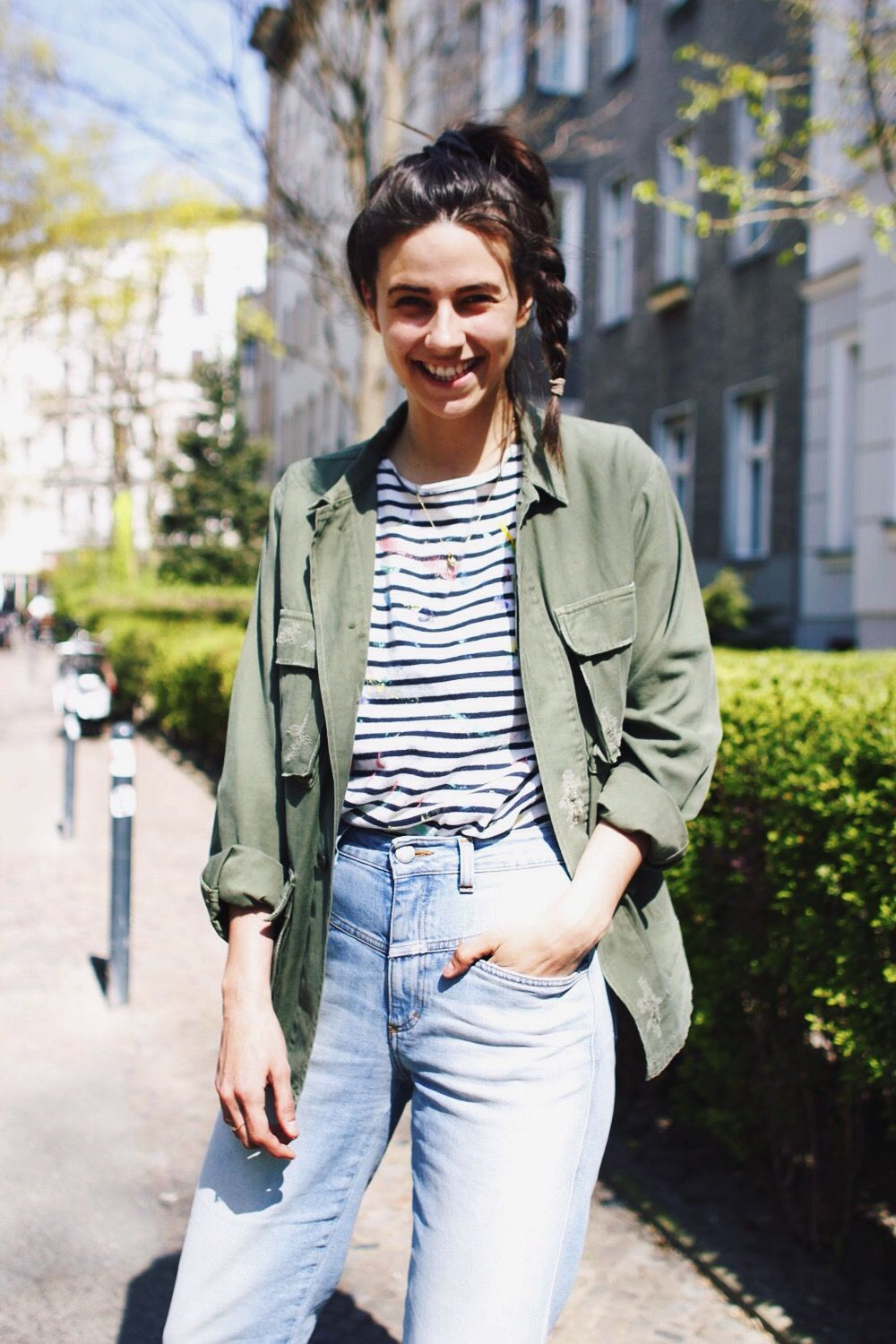 53a2e27843 A striped t-shirt is paired with an army jacket