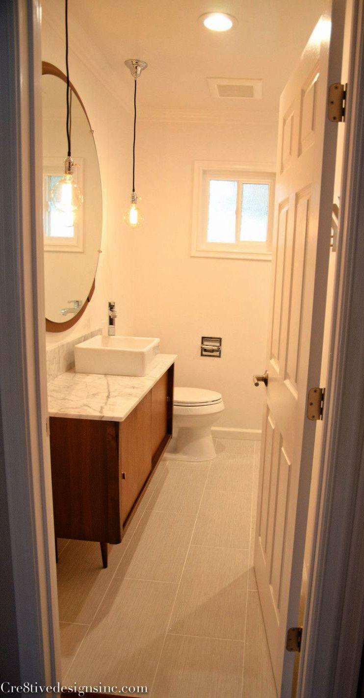 Midcentury modern bathroom vanity beautifully washed up
