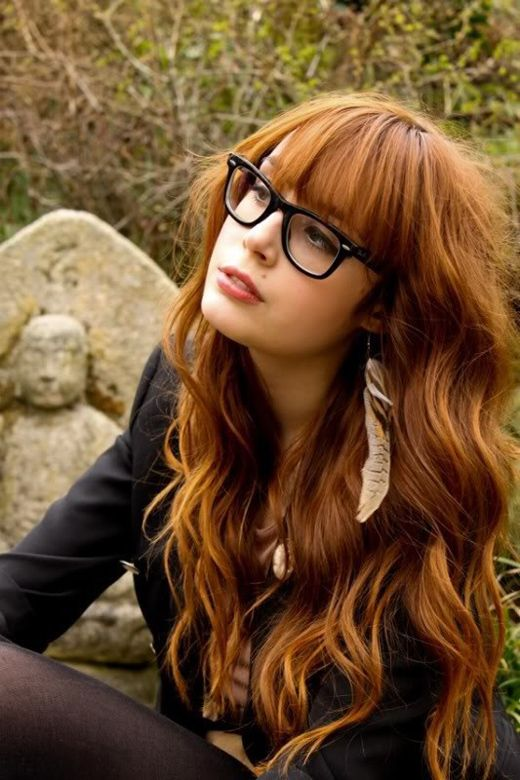 Long Wavy Red Hair With Bangs Hairstyle And Black Framed Glasses Hair Styles Long Hair Styles Long Wavy Hair