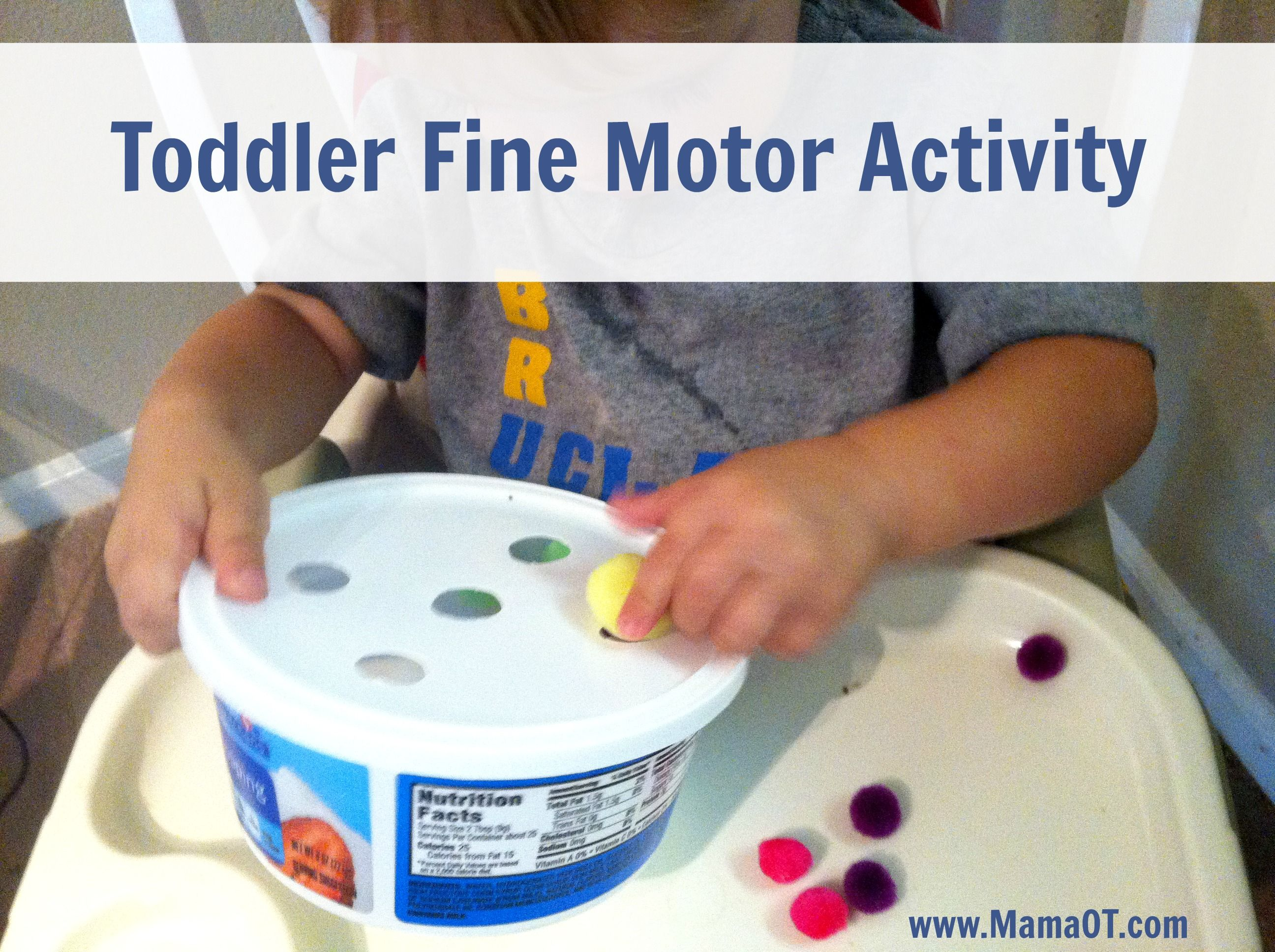 Toddler Fine Motor Activity with Pom Poms and a Plastic Container