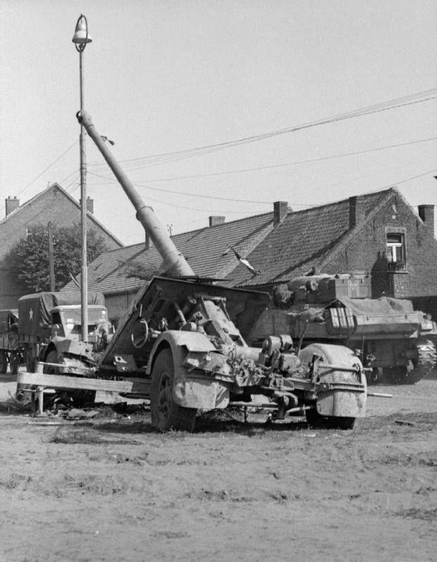 German 50 Mm Anti Tank Gun: Guards Armoured Division Sherman Tanks Pass An Abandoned