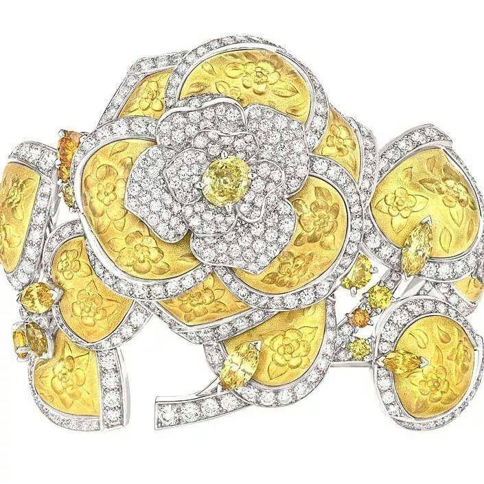 'Camélia Solaire' bracelet in white and yellow gold, set with 487 brilliant-cut diamonds with a total weight of 11.2ct, 7 marquise-cut yellow diamonds with a total weight of 2.6ct, 9 brilliant-cut yellow diamonds with a total weight of 2ct and a 1.2ct oval-cut yellow diamond. #wantneeddesirecovet #JewelGasm #jewelleryaddict #jewelleryporn #mrsortonsinstaglam