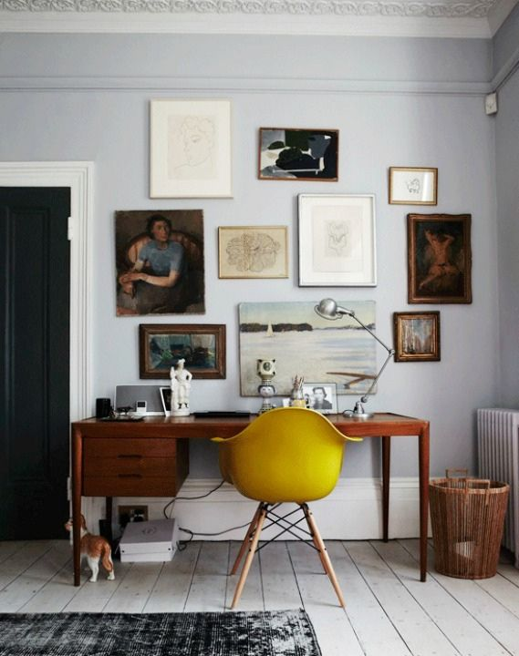 the pale blue-gray paint and bright yellow mustard color chair
