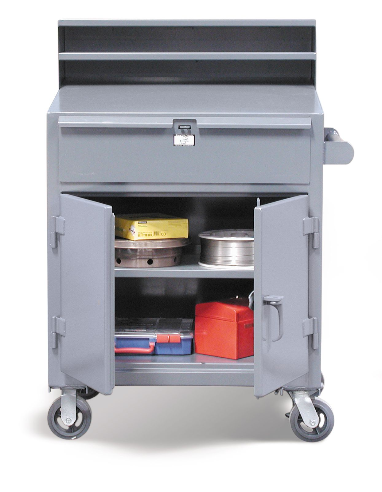 Mobile Shop Desk - These standard mobile shop desks are made for heavy duty 12 gauge steel and are designed to last. The casters are 2 inches x 6 inches and make moving this desk around your shop easy. Our shop desks are commonly found in assembly areas, maintenance departments, warehouses and on shipping and receiving docks. Our desks feature a 3-point locking system and a wrap around design.
