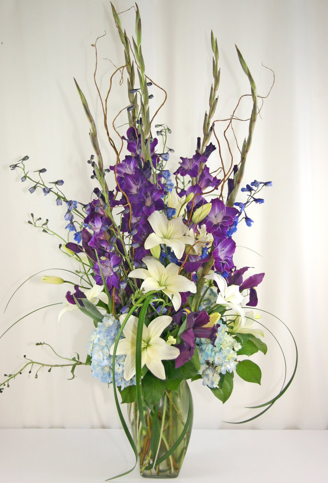 Image result for tall funeral arrangements funeral pinterest image result for tall funeral arrangements blue and whitepurplevaseflowers search izmirmasajfo