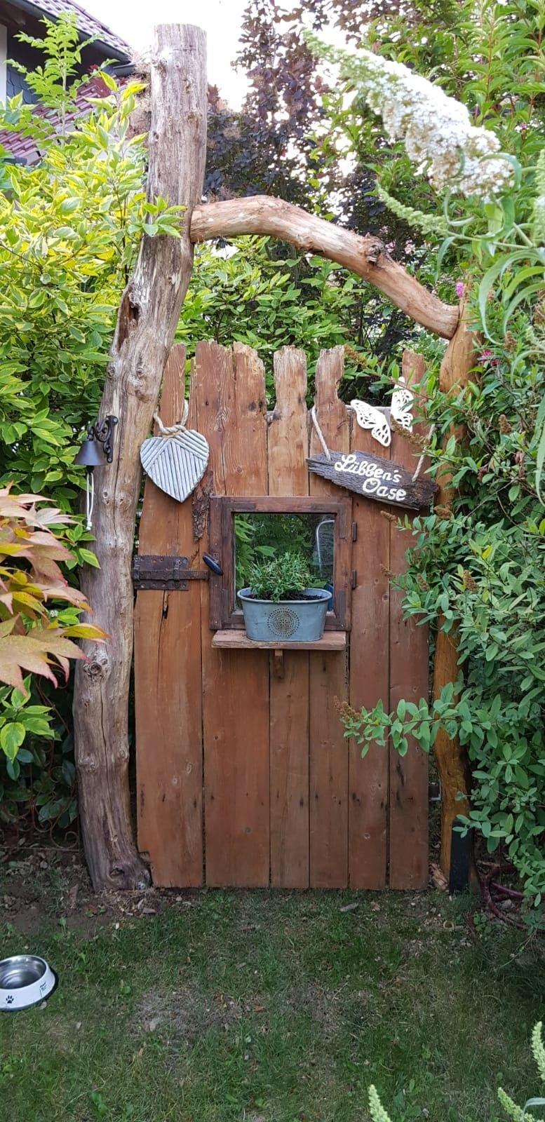 Hidden paradise, secret garden door  Wooden door hobbit