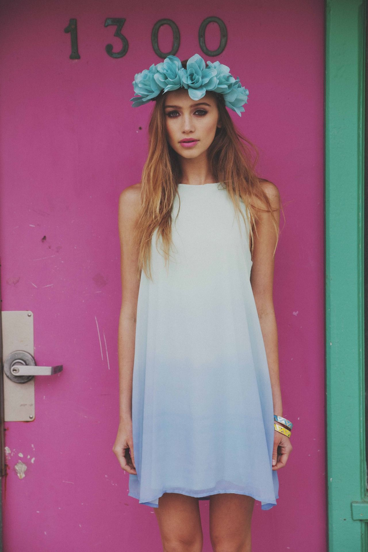 Blue flowers headband with a blue ombre dress and a beautiful pink door in the background...!