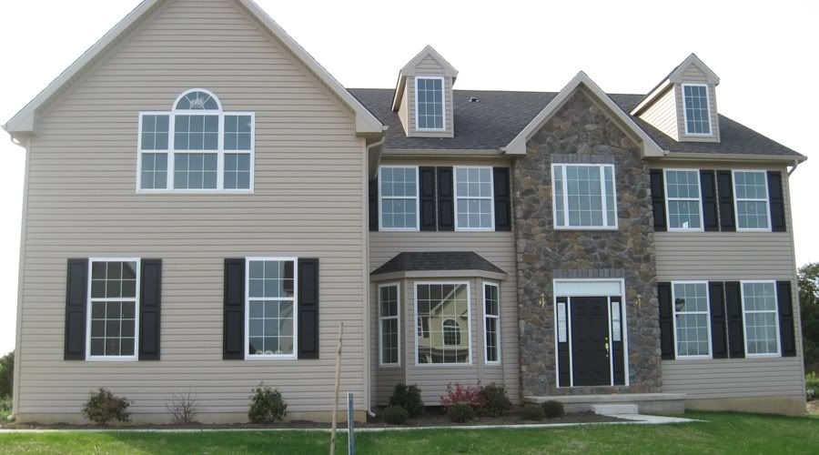 i am thinking black or dark gray roof navy shutters and tuscan