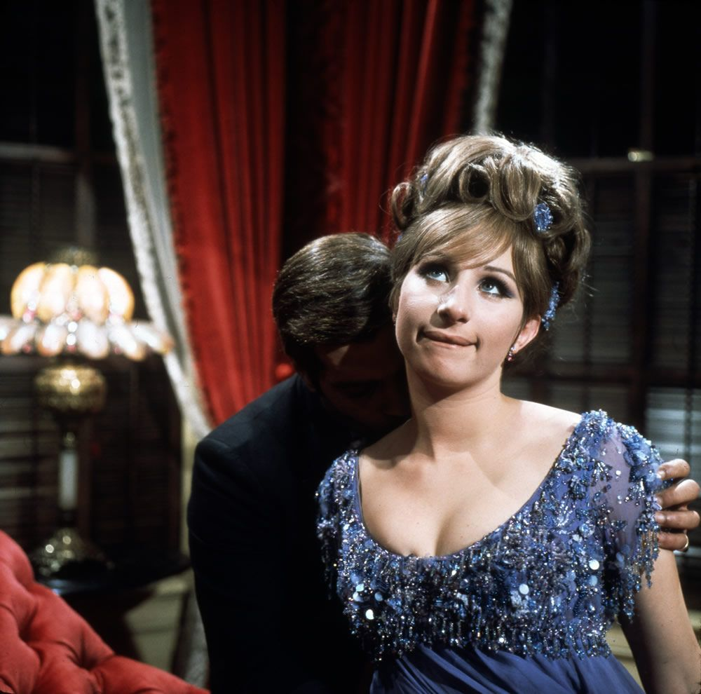 Streisand with a shadowed Omar Sharif in a still from FUNNY GIRL