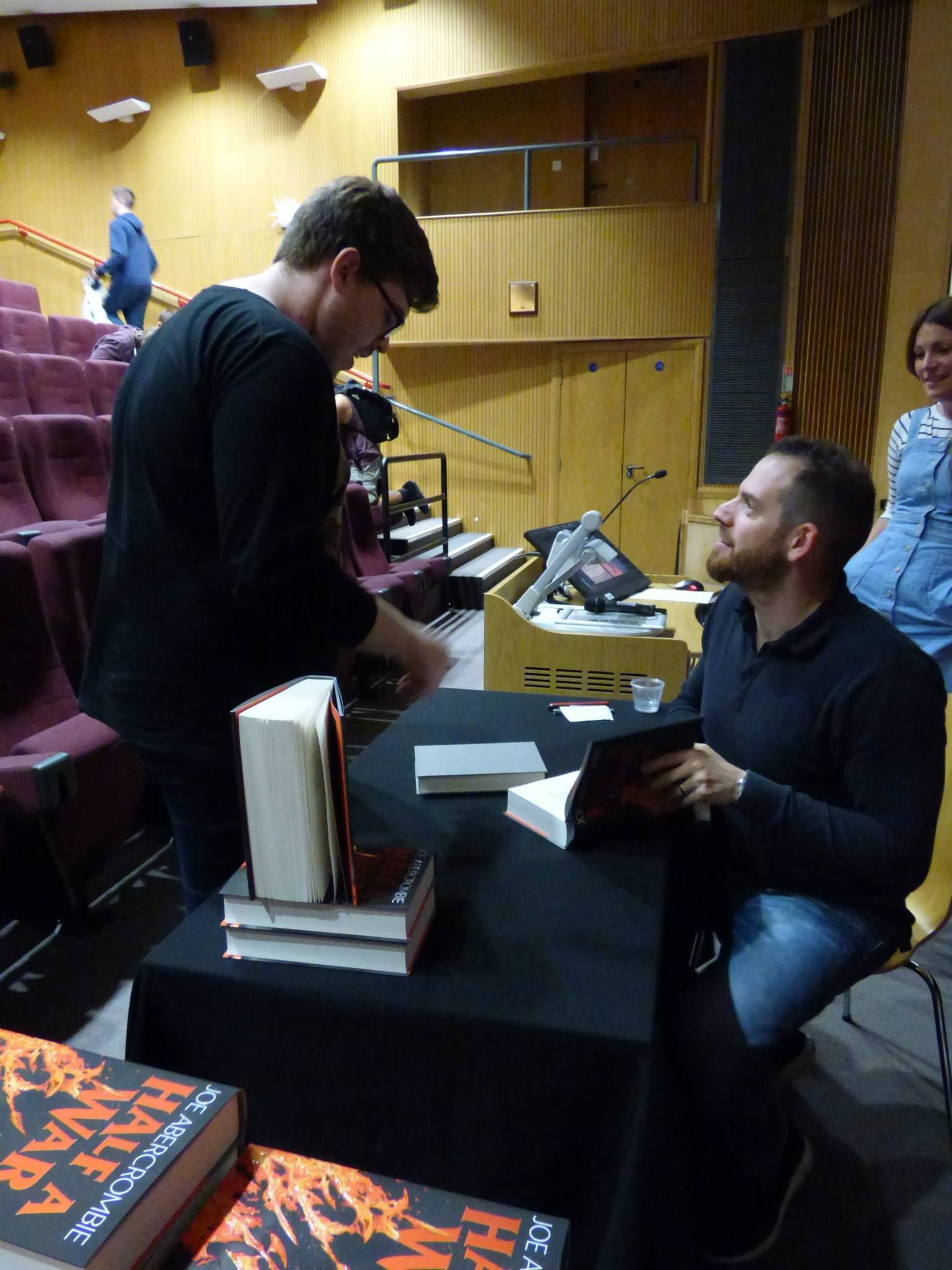 Joe Abercrombie has a chat and signs a copy of Half a War for a customer on July 14th.