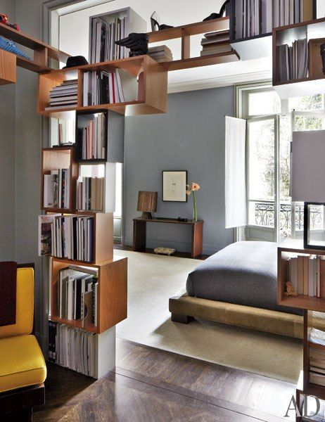 nice idea of a book case as a sculptural element, creating a doorway