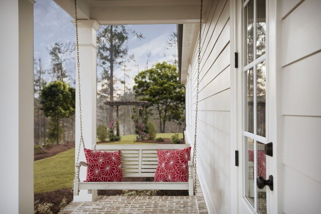 Front porch swings invite nature and quiet pauses