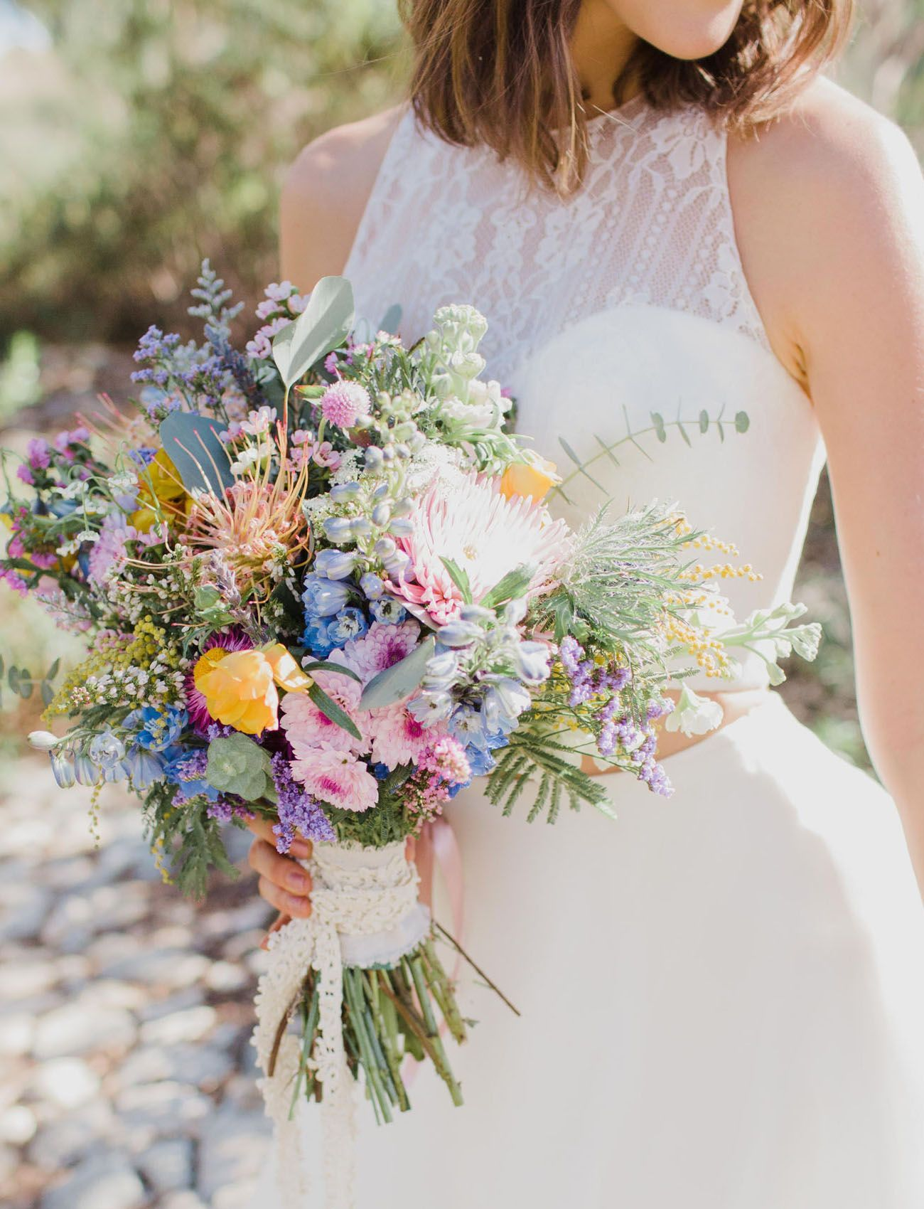 Bright poppy spring bouquet with blue and purple hues