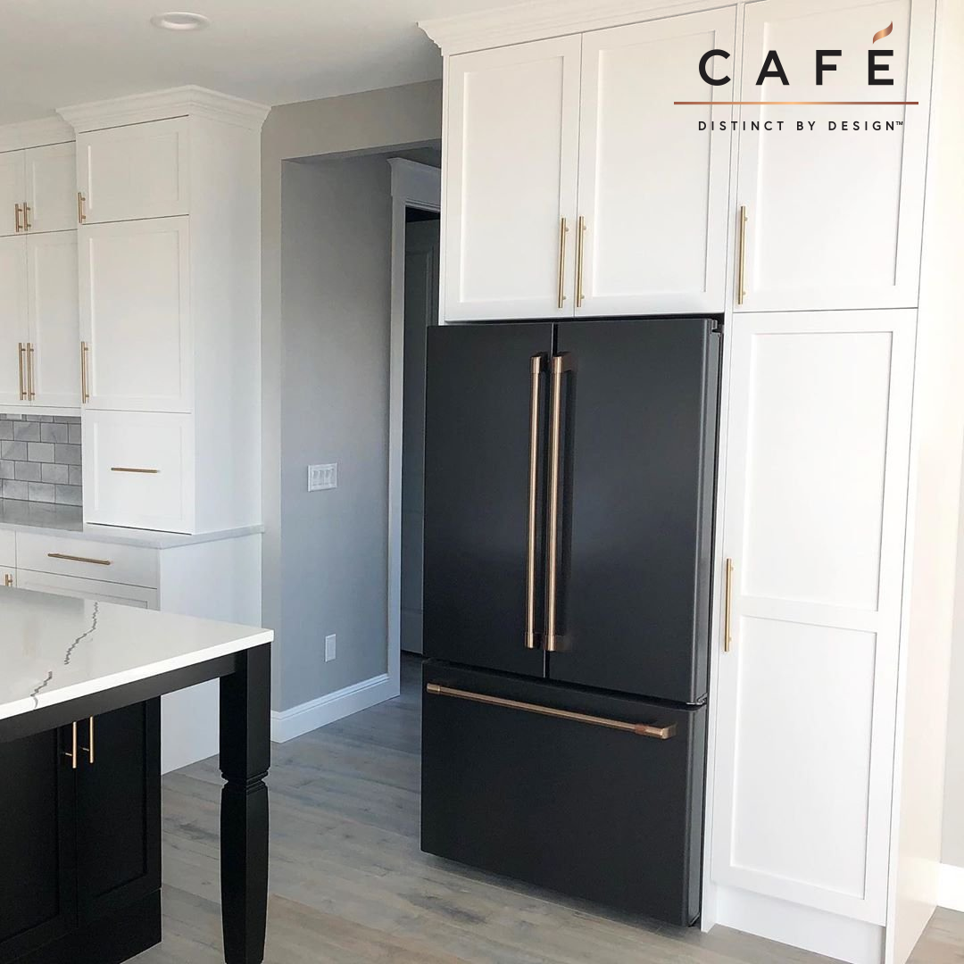 Beautiful Contrast Of Matte Black Cafe Appliances And Warm White Cabinetry In White Kitchen Black Appliances Black Appliances Kitchen White Kitchen Appliances