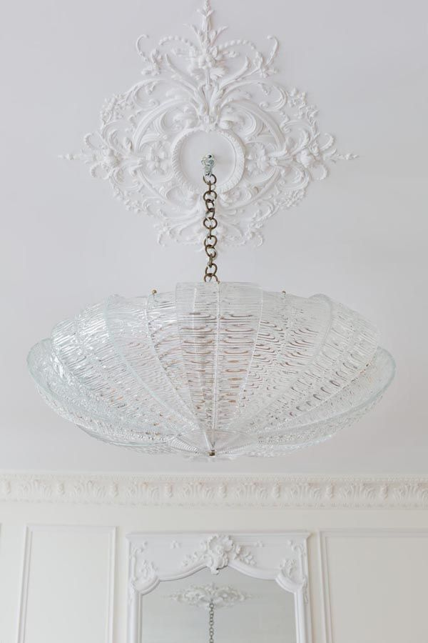 Bonaparte Chandelier | A+B Kasha, Luxury property in Paris | beautiful white ceiling medallion molding and glass chandelier... the modern traditional decor i love so much with a touch of whimsy!