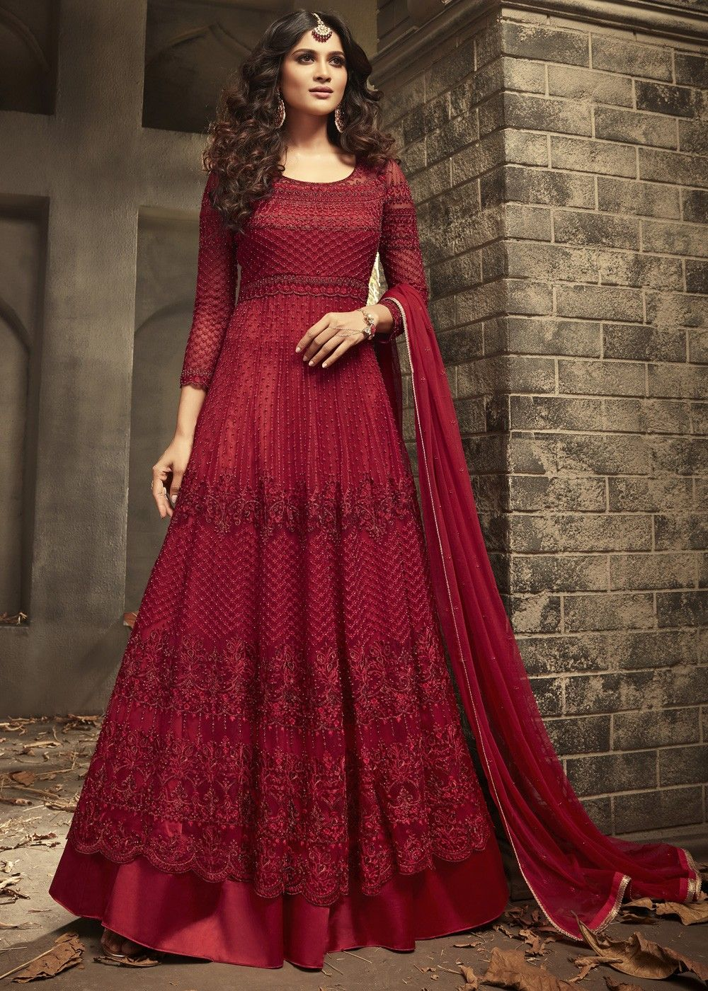 56a3292b4b Red Anarkali Style suit In Net Embellished With All Over Heavy Embroidery,  Sequins And Stone Work.