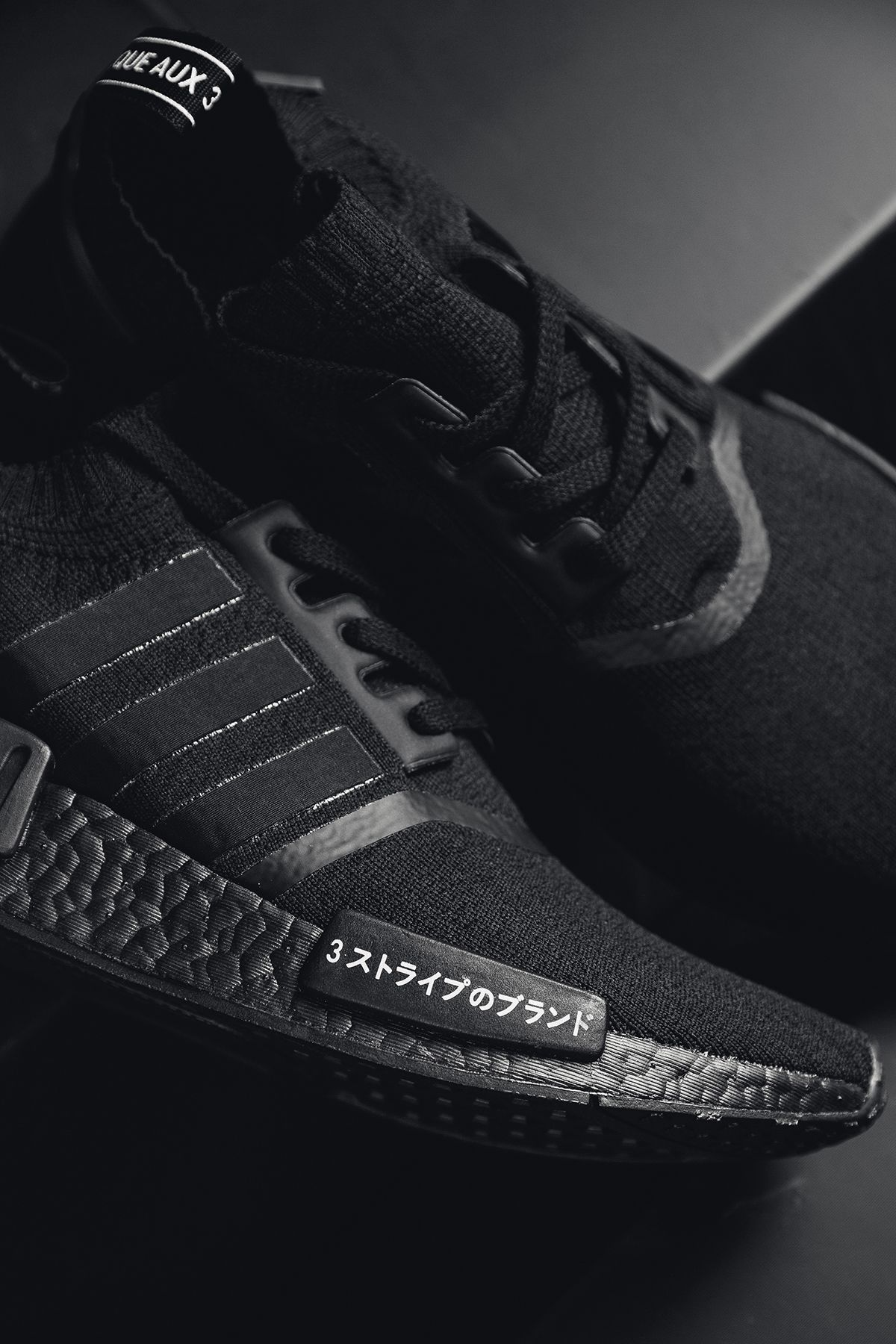 fa98011ab5403 Adidas Originals NMD_R1 Primeknit Triple Black