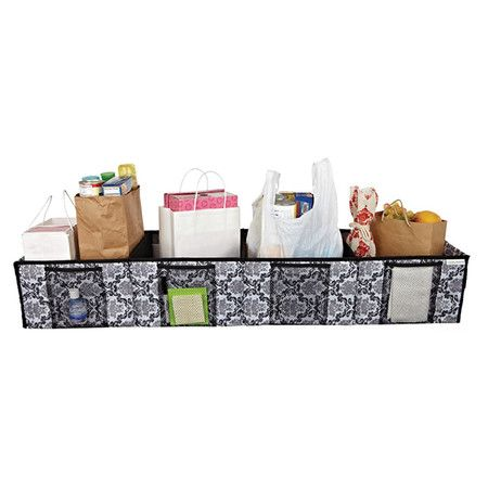 Trunk organizer with four mesh pockets and a damask motif.     Product: Trunk organizerConstruction Material: Pol...