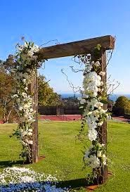 Country Wedding Floral Inspiration  = COUNTRY WEDDING ARBORS - BEAUTIFUL WHITE COUNTRY WEDDING ARBOR