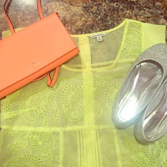 Sheer Neon Lime Green Eyelet AE Top EUC lime green eyelet top from American Eagle. This was worn once and will be perfect for spring and summer. Shirt is sheer with buttons going half way down the back. American Eagle Outfitters Tops Blouses