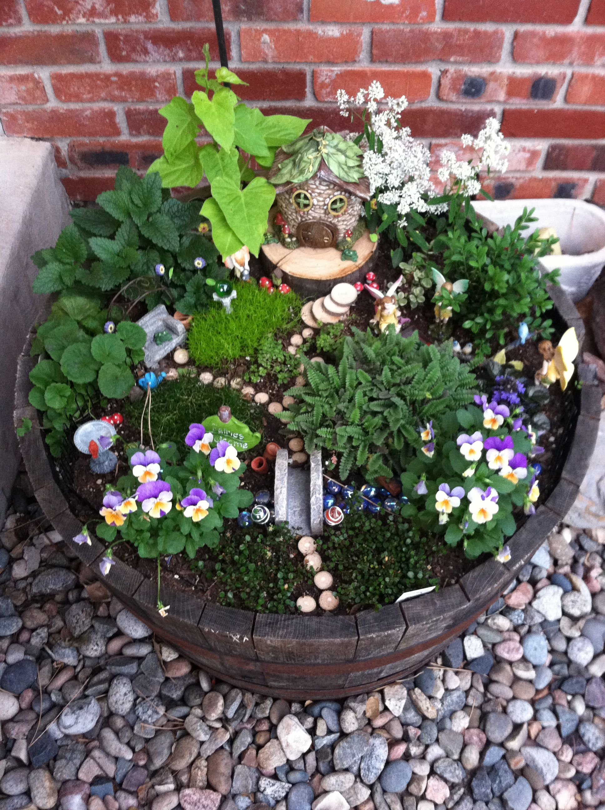Fairy Garden In Whiskey Barrel Large Fairy Garden Fairy Garden Containers Fairy Garden