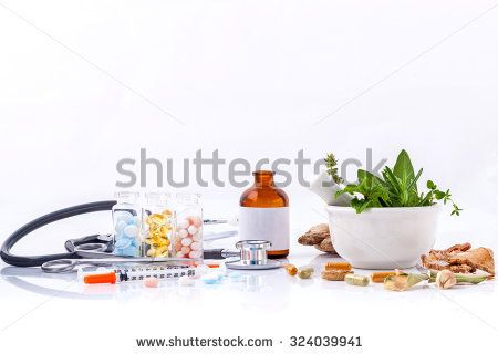 Herbal medicine VS Chemical medicine the alternative healthy care with stethoscope isolated on white background.