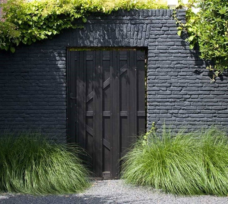 Pin By Ricardo On Black Brick Wall Gardens Painted Brick Exteriors Landscape Design