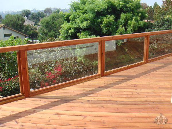 Redwood Deck With Glass Panel Railings That Easily Let In The Breathtaking View Deck Designed By Block Islan Deck Railings Glass Railing Deck Railings Outdoor