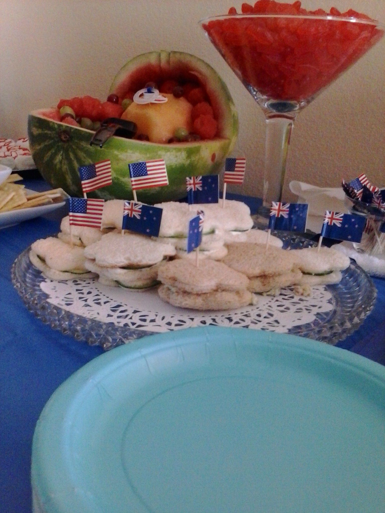 """Had an """"Ahoy it's a boy"""" themed baby shower. The father is from New Zealand and travels on yachts so I thought this was the perfect combination. The sandwiches had each flag in them, the watermelon was a baby, and the wine glass was full of Swedish fish"""