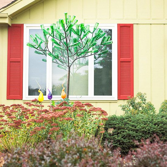 I love this bottle tree. It looks fantastic with all green bottles. http://www.bhg.com/home-improvement/exteriors/curb-appeal/curb-appeal-tips/#page=10