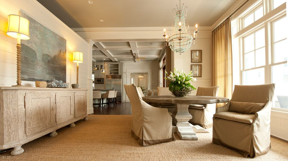 lots of ideas I can use here: love the neutrals, slipcovered dining chairs, long buffet with large painting, simple rug underfoot.