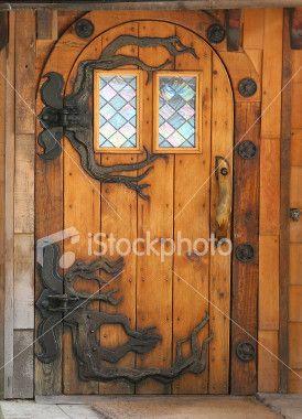 Hand Made Wooden Door With Fancy Hobbit Hinges Unique Front Doors Wooden Front Doors Front Door Hardware