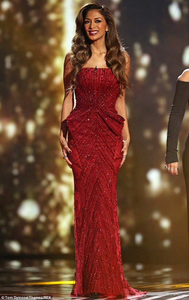 Lady in red: Nicole Scherzinger well and truly stole the sartorial show as she arrived at Wembley Arena for the first stage of the X Factor ...
