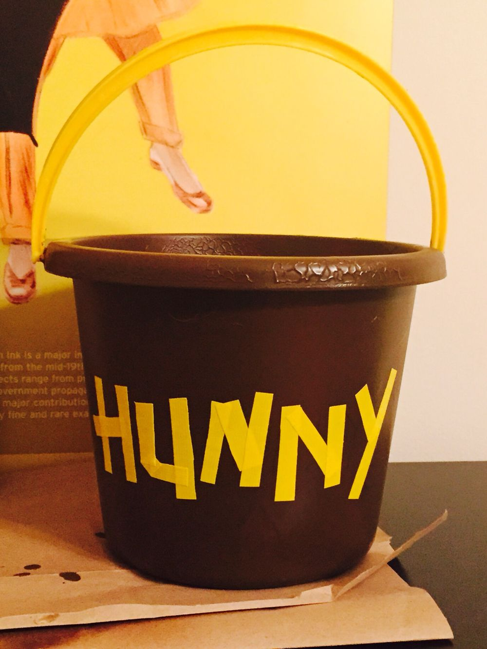 0fd6929692c0 DIY Winnie the Pooh Hunny Pot - brown spray paint and yellow duct tape