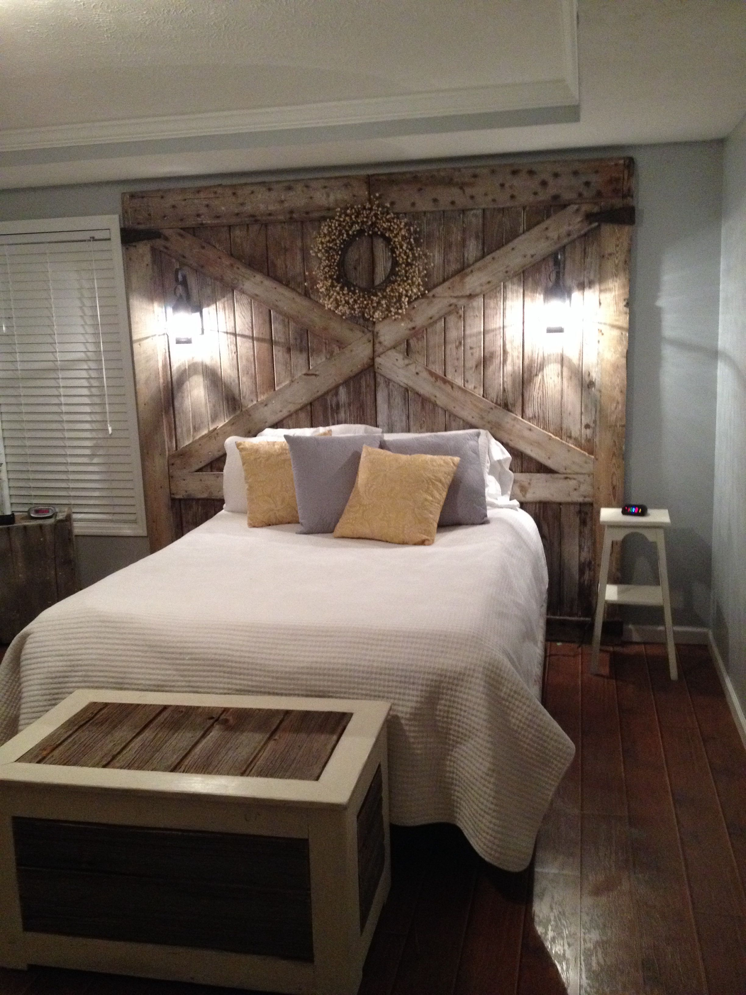 Barn wood headboard with lights Rustic bedroom