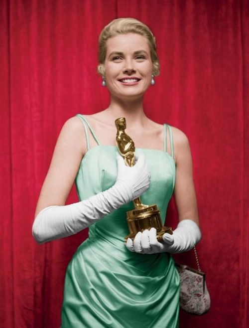 Grace Kelly with her Oscar for The Country Girl (1954). Her blue champagne silk gown was designed by Edith Head. #hollywoodicons