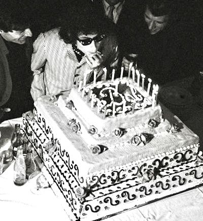 Bob Dylan Blowing Out Candles On His Birthday Cake