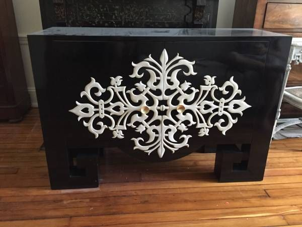 dramatic black lacquer sideboard with white filigree detail