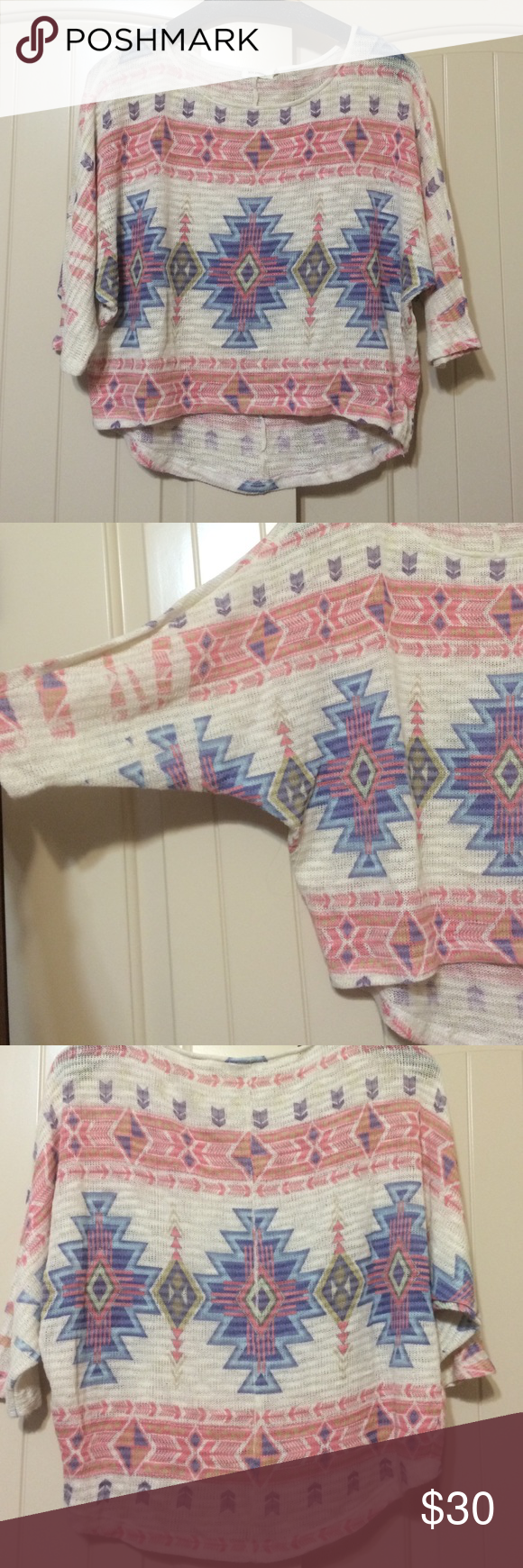Tribal sweater Short tribal sweater. Worn once. Elbow length sleeve. Size small. Sweaters Crew & Scoop Necks