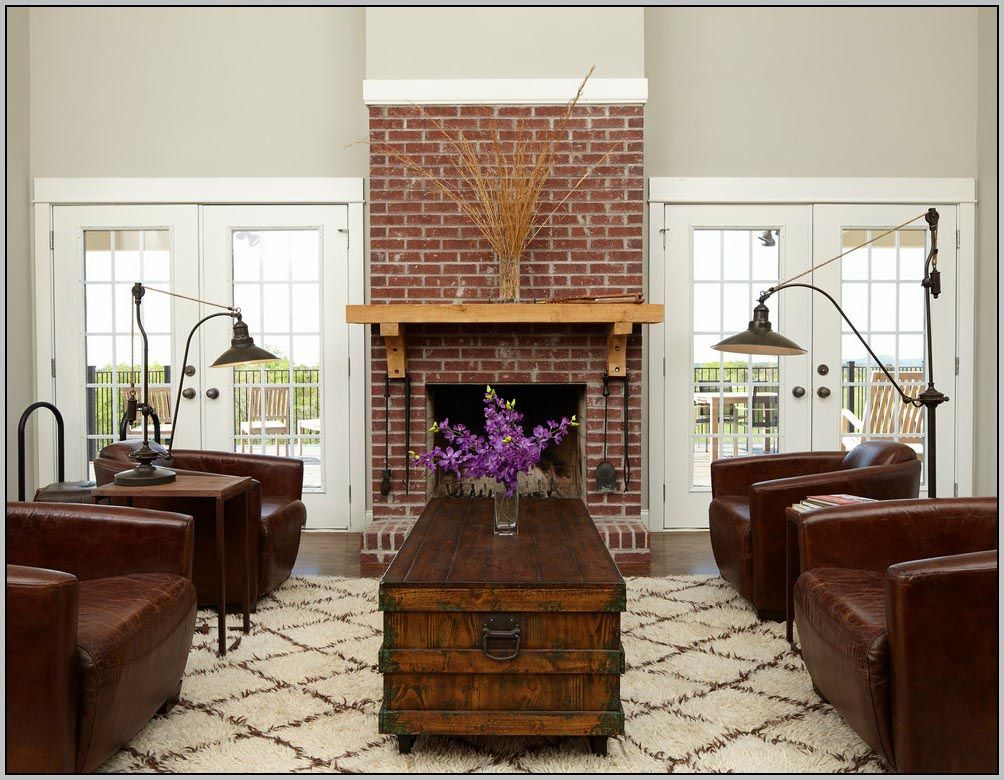 Living room with red brick fireplace
