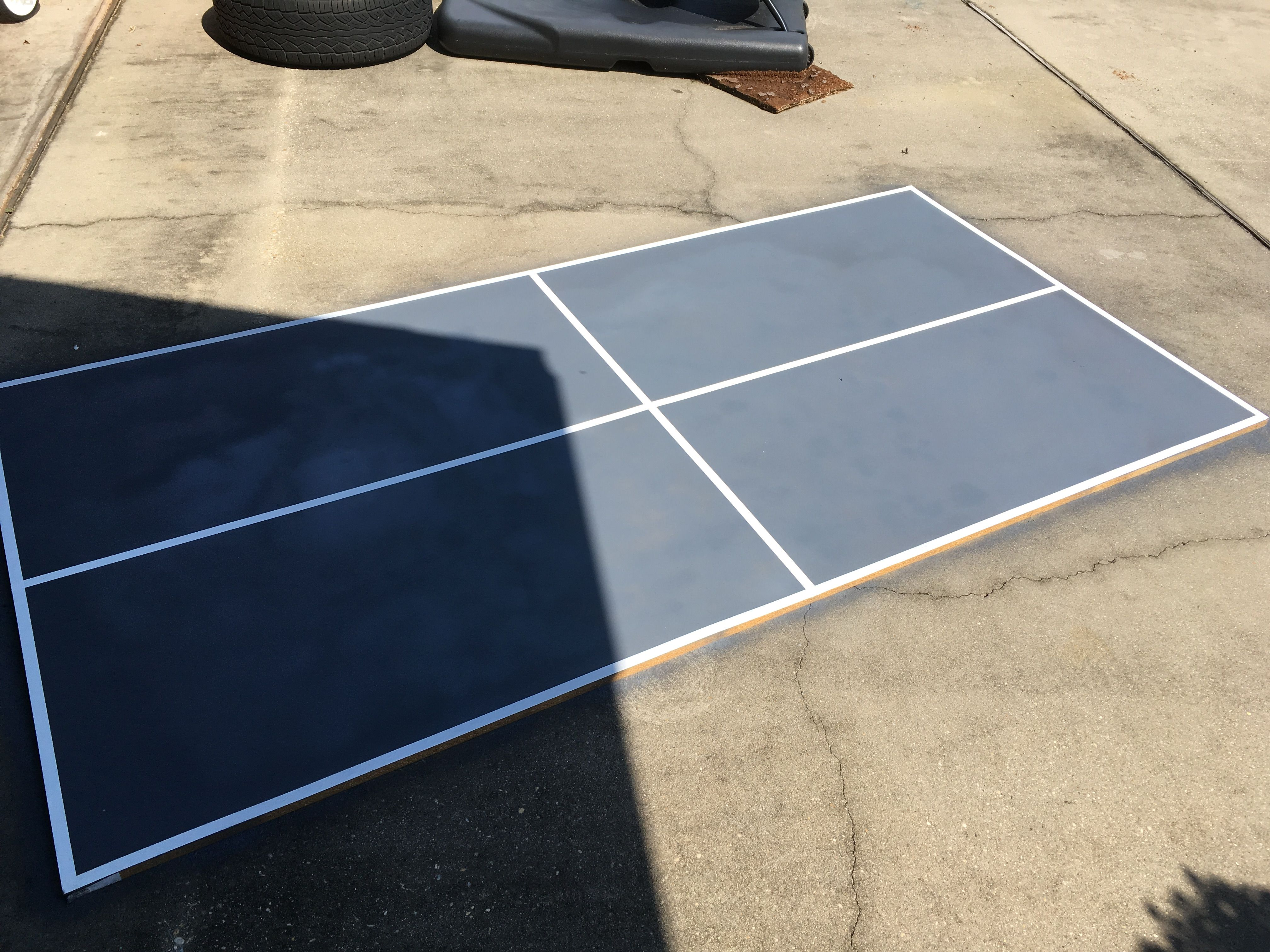 Diy Ping Pong Table Top Under 25 8x4 3 4 Grey Paint And White Electrical Tape Sits Perfect On Back Pa Ping Pong Table Top Ping Pong Table Diy Diy Table Top