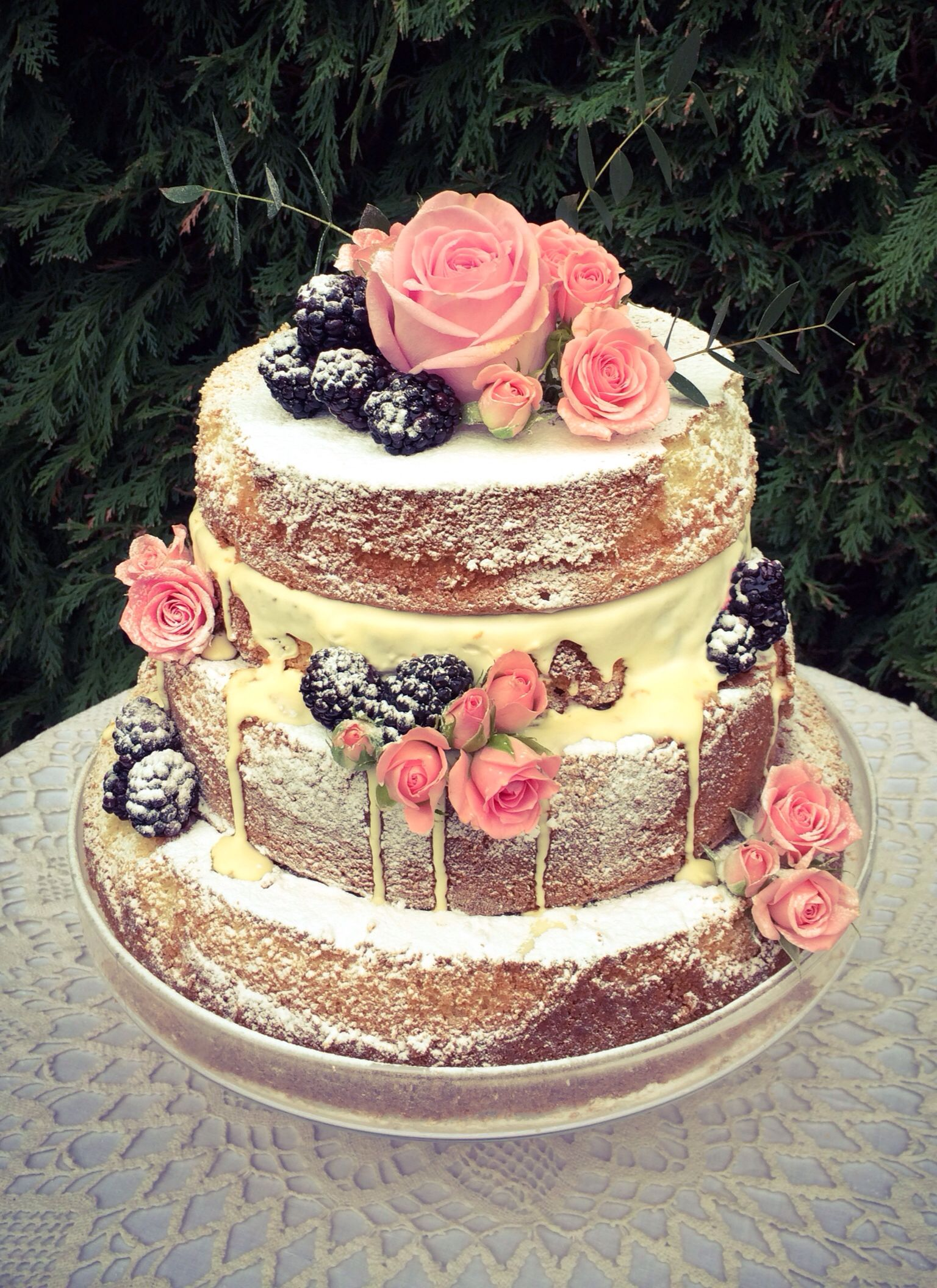 Naked wedding cake pink roses and blackberries wedding delicious
