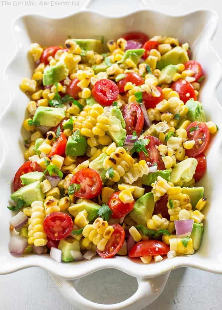 This Corn, Avocado, and Tomato Salad is a fresh and light side dish perfect for summer BBQs and potlucks. It's a fresh and light side dish that screams summer!