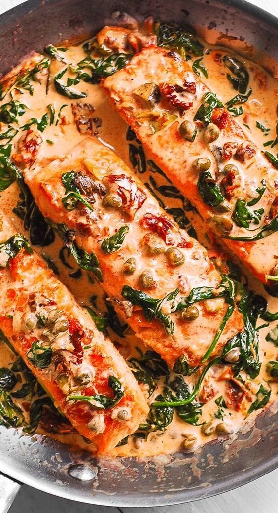 Photo of Pan-Seared Creamy Tuscan Salmon with Garlic, Spinach, Artichokes, Sun-Dried Tomatoes, and Capers