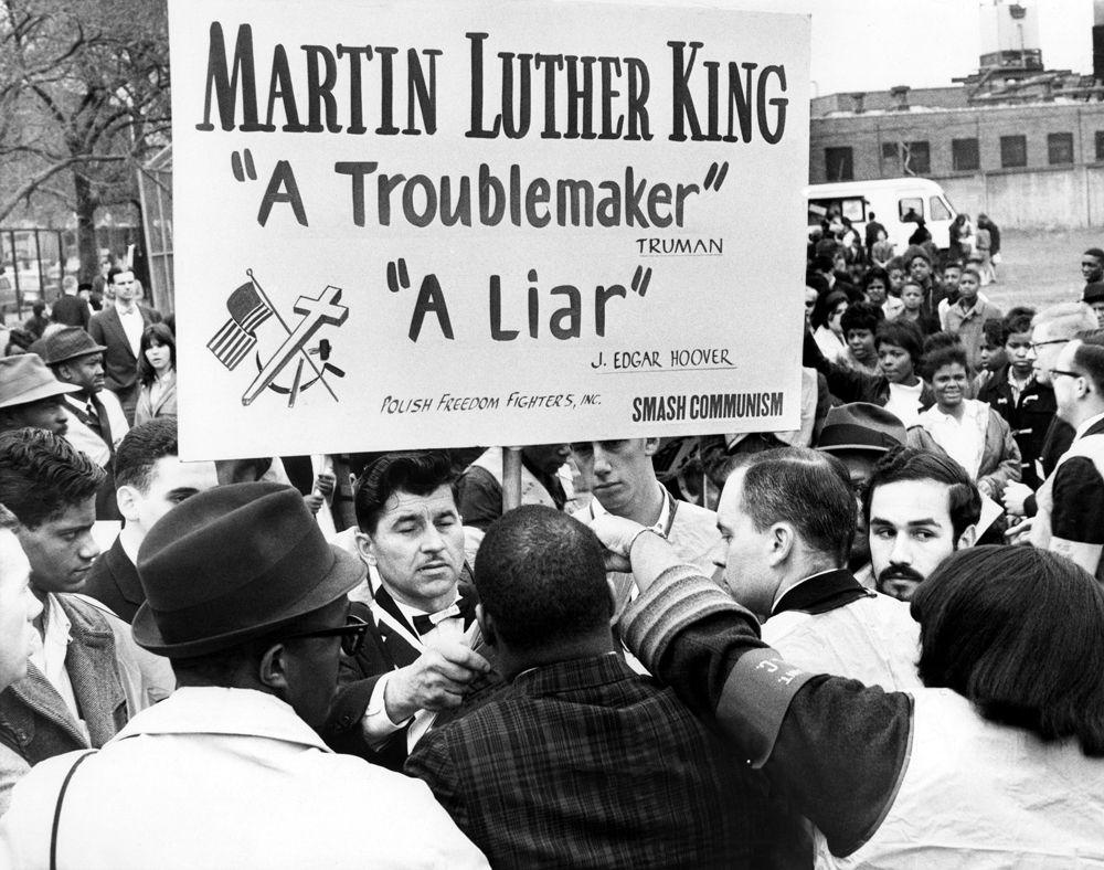 A Polish Refugee Jozef Mlot Mroz Of Salem Carries A Sign Denouncing Dr Martin Luther K Martin Luther King Dr Martin Luther King Jr African American History