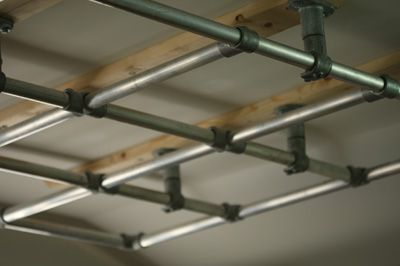 Wall mount frame like a Lighting Grid, for mounting benches, tables, work surfaces, etc to.