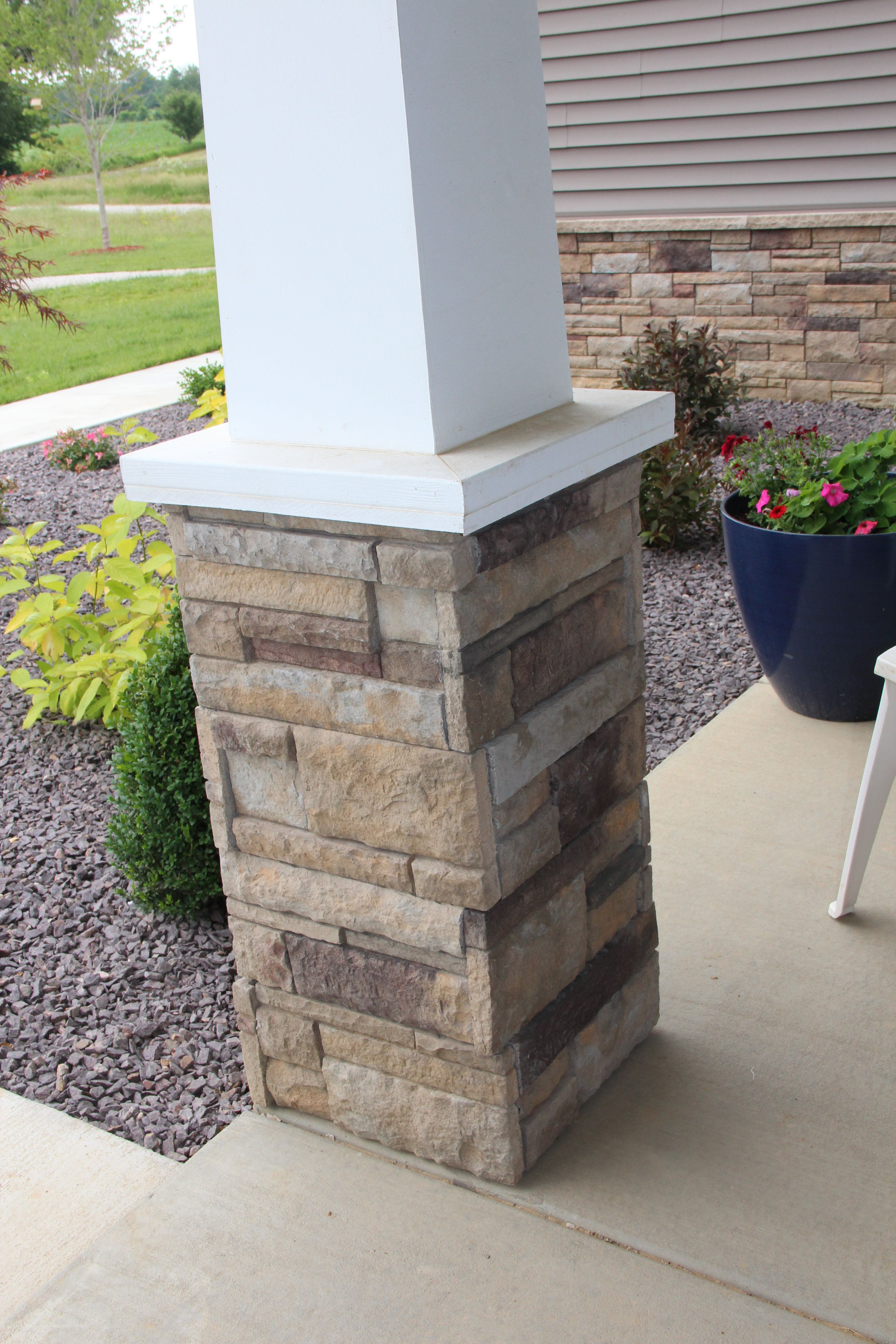 Versetta Stone on front porch column modern craftsman style home