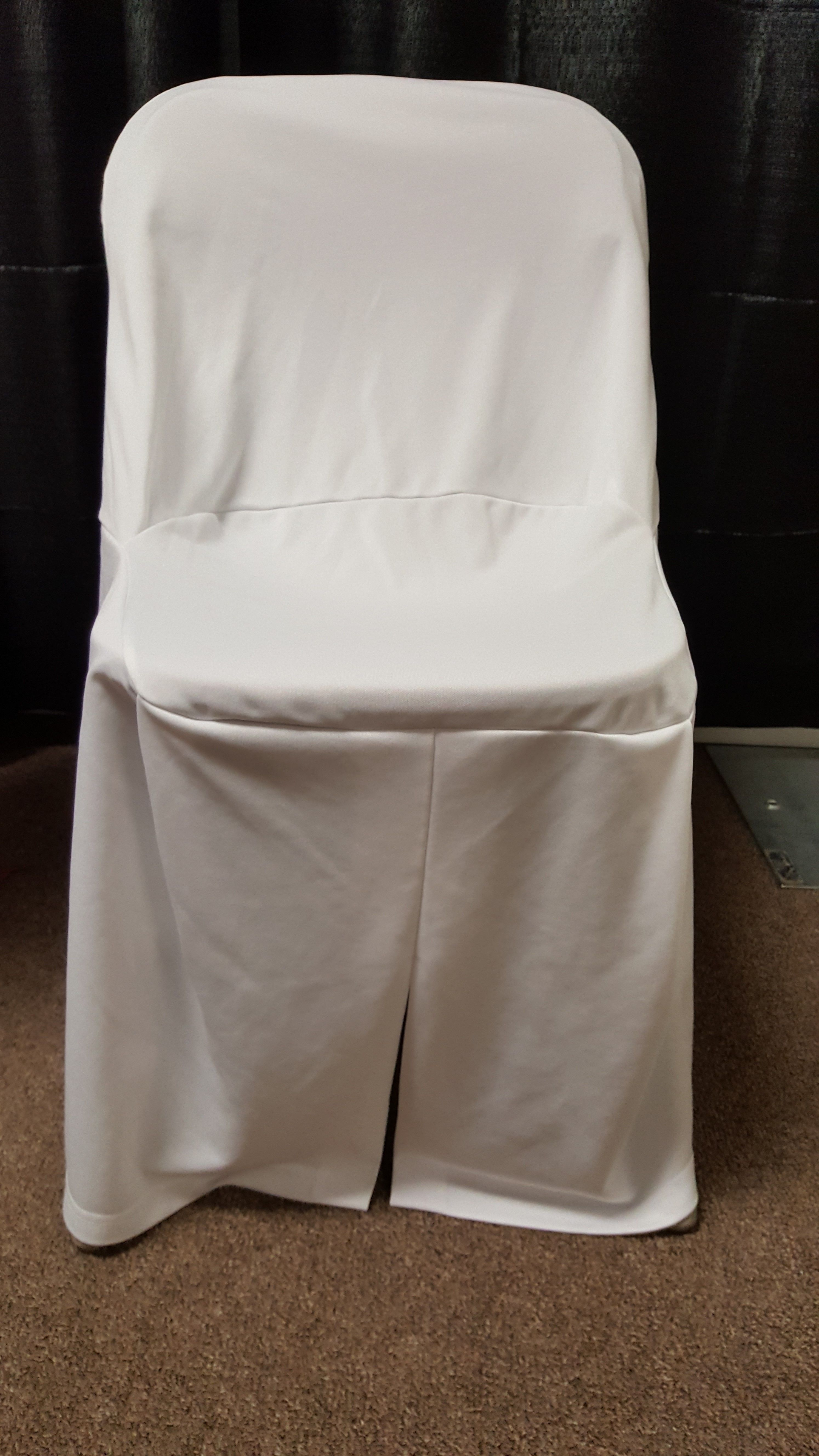 White folding chair cover displayed on burgundy folding chair